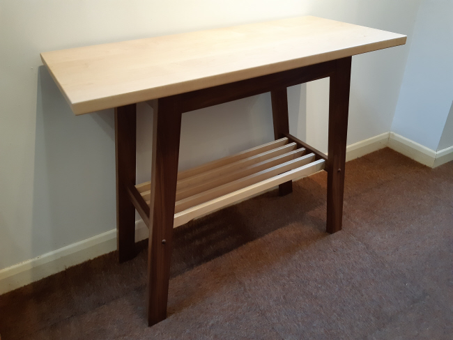 Side table, walnut frame, maple top, slatted shelf. New from stock